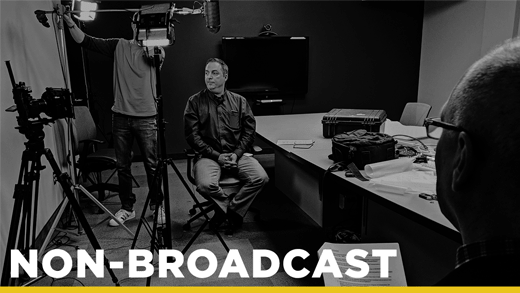 black and white photo of a man in an interview representing our broadcast work